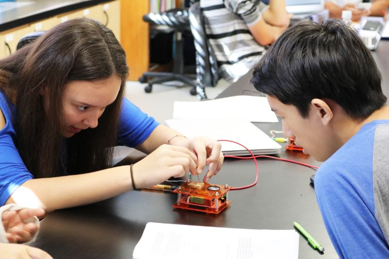 Grauer students testing an electrical device